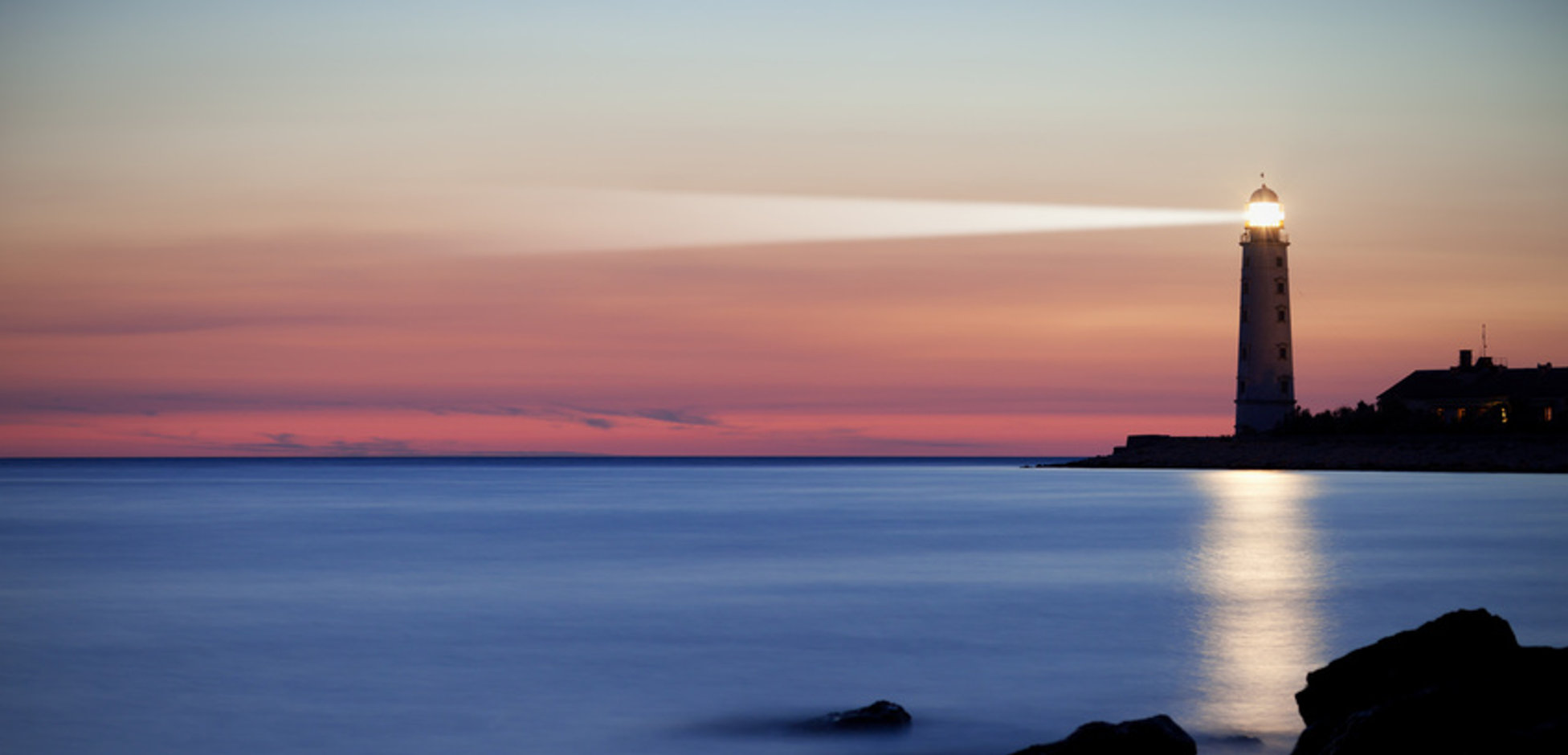 Seascape at sunset. Lighthouse on the coast